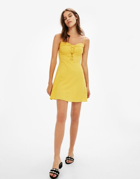 vestido lino mostaza 25,99 bershka